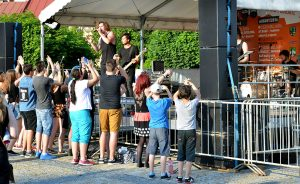 Open air concert of rock music band with a very small audience