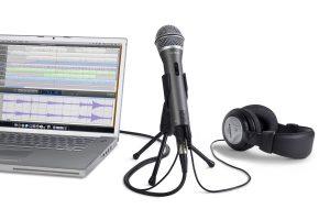 Samson Q2U microphone on stand connected to laptop